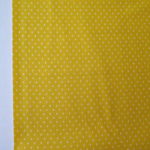 tela estampadas de pequeños lunares amarilla